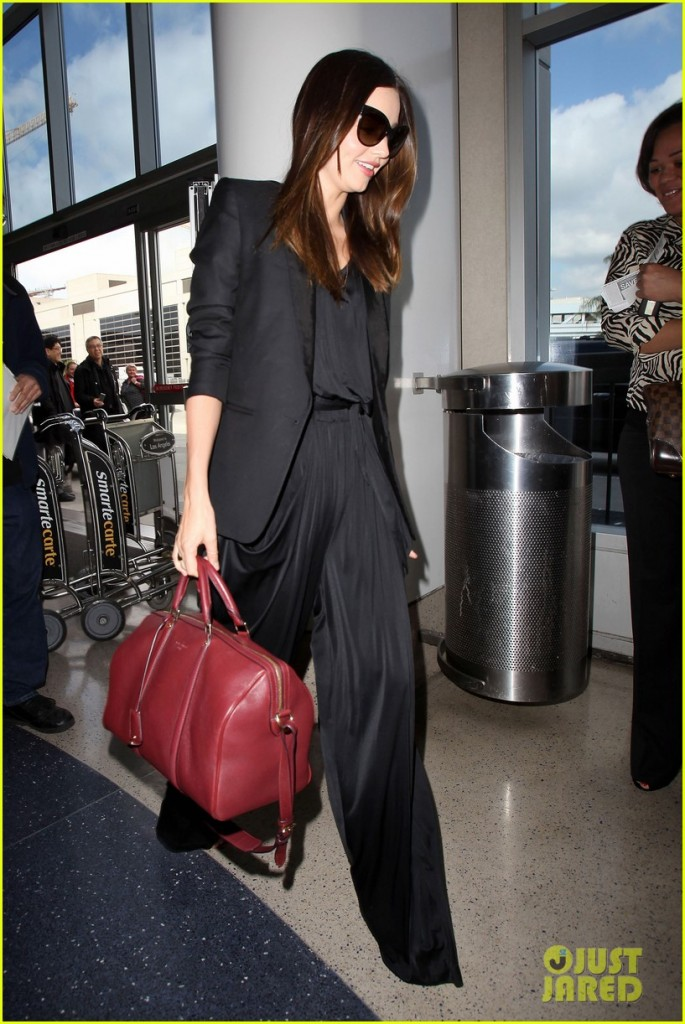 Los Angeles, CA - Miranda Kerr leaves LAX looking chic in all black and carrying maroon designer bag. The Victoria's Secret model has been promoting her skincare product called KORA Organics Skincare which is natural and designed to replenish and hydrate the skin. GSI Media March 1, 2012 To License These Photos, Please Contact : Steve Ginsburg (310) 505-8447 (323) 4239397 steve@ginsburgspalyinc.com sales@ginsburgspalyinc.com or Keith Stockwell (310) 261-8649 (323) 325-8055 keith@ginsburgspalyinc.com ginsburgspalyinc@gmail.com